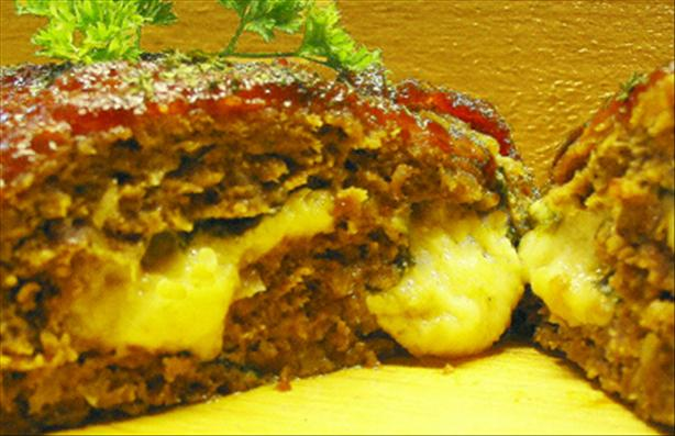 Spinach-Cheese Stuffed Meatloaf. Photo by Caroline Cooks