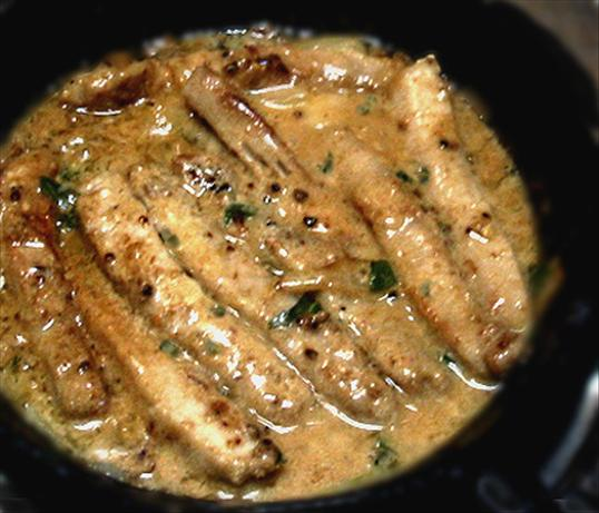 Creamy Herbed Pork Chops.. Photo by Caroline Cooks