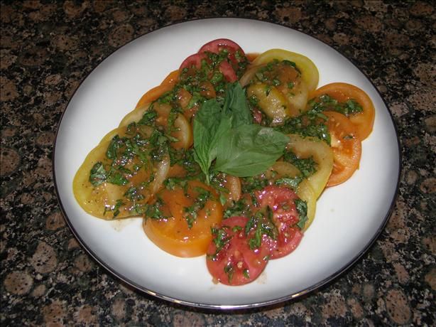 Tomato Salad With Fresh Basil Dressing. Photo by Juenessa