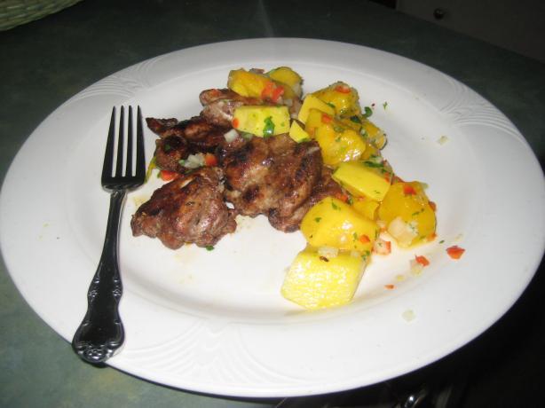 Jerk Chicken Thighs With Mango Salsa. Photo by Dorichan