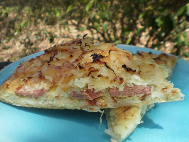 Pizza With Sausage, Sauerkraut & Swiss Cheese. Photo by breezermom