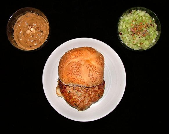 Chicken Burgers with Satay Sauce and Spicy Cucumber Relish. Photo by m ...