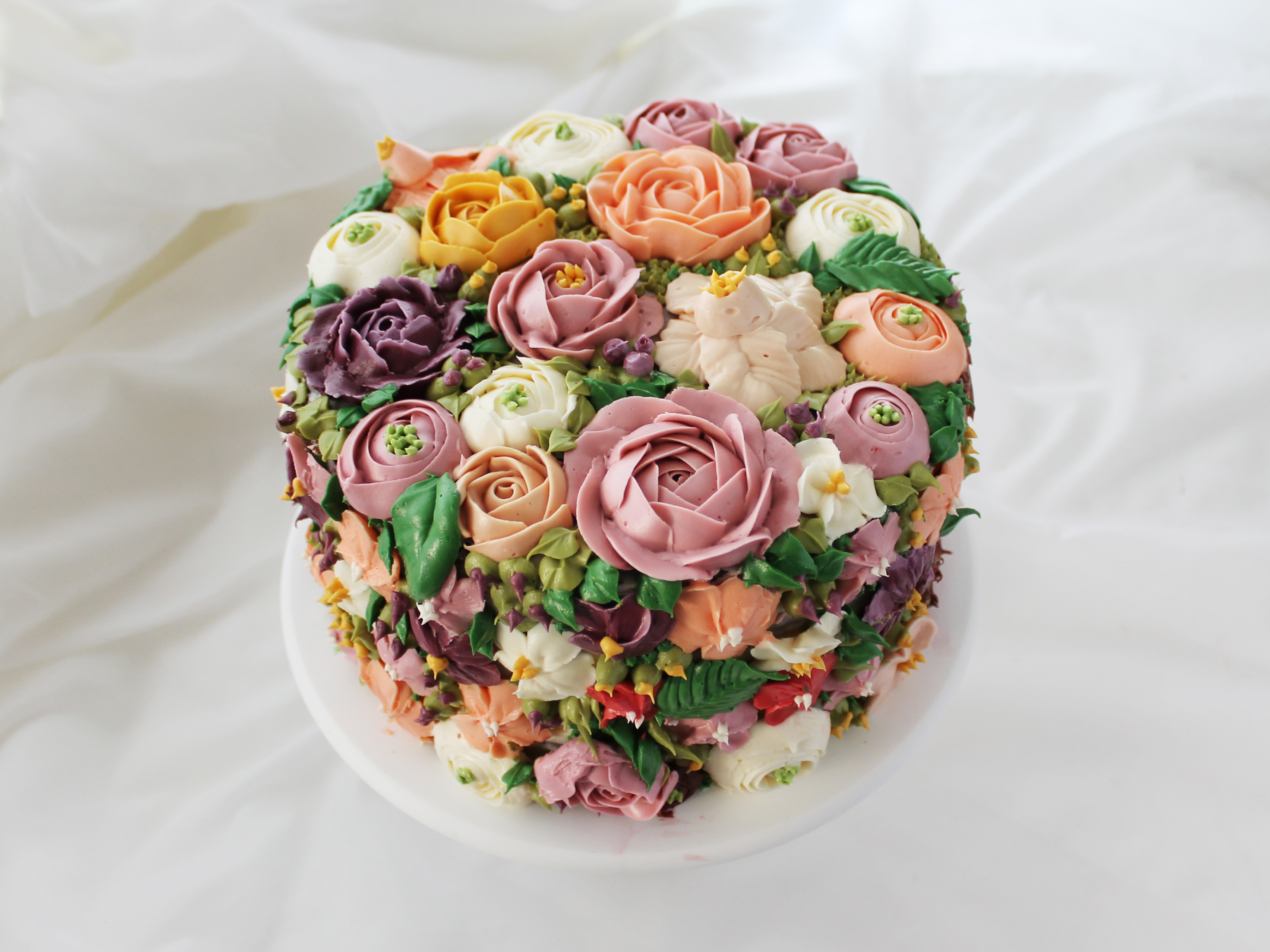 How to make icing flowers for a flower cake genius kitchen izmirmasajfo